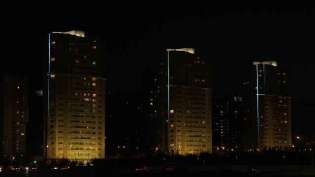 Central Asia, Kazakhstan, Astana, night time illumination on residential apartment buildings