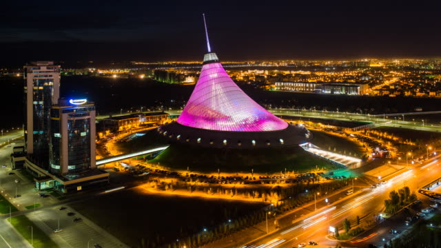 central asia, kazakhstan, astana, night view over khan shatyr entertainment center- time lapse - arts culture and entertainment stock videos & royalty-free footage