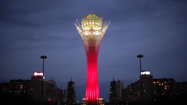 Central Asia, Kazakhstan, Astana, Nurzhol Bulvar - Bayterek Tower illuminated at night