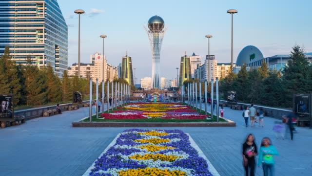 central asia, kazakhstan, astana, nurzhol bulvar - central boulevard and  bayterek tower illuminated at night - kazakhstan stock videos and b-roll footage