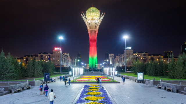 central asia, kazakhstan, astana, nurzhol bulvar - central boulevard and  bayterek tower illuminated at night - kazakhstan stock videos & royalty-free footage