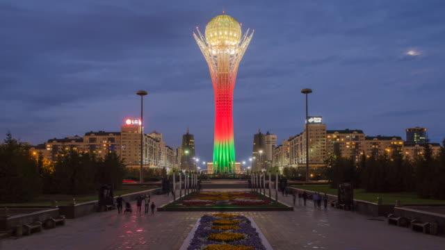 Central Asia, Kazakhstan, Astana, Nurzhol Bulvar - Central Boulevard and  Bayterek Tower illuminated at night- Time lapse