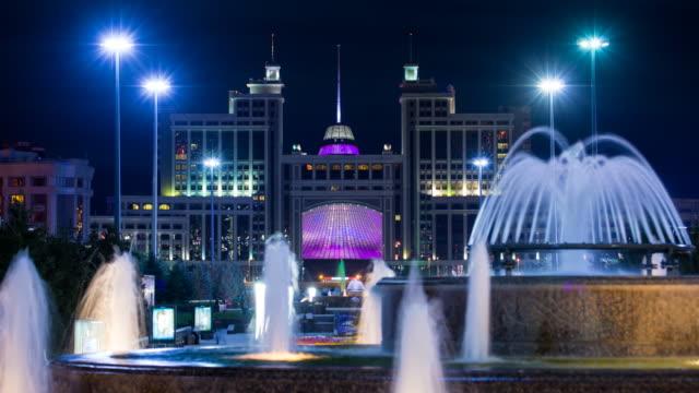 Central Asia, Kazakhstan, Astana, Nurzhol Bulvar - Fountains in front of the KazMunaiGas building,  - Time lapse
