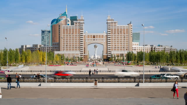 Central Asia, Kazakhstan, Astana, Nurzhol Bulvar - KazMunaiGas building, time lapse