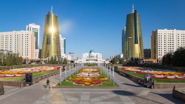 central asia, kazakhstan, astana, presidential palace and the twin golden conical business centres - time lapse - kazakhstan stock videos & royalty-free footage