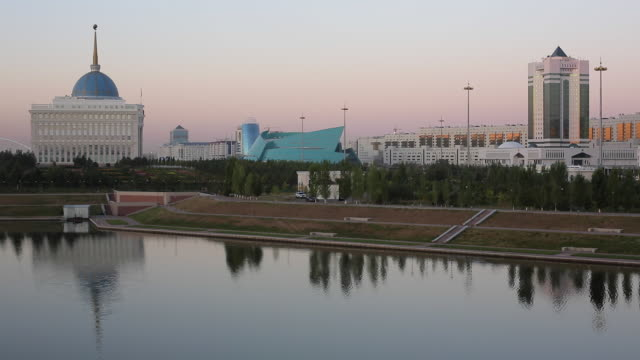 Central Asia, Kazakhstan, Astana, View of city reflecting in Isahim River and Ak Orda Presidential Palace