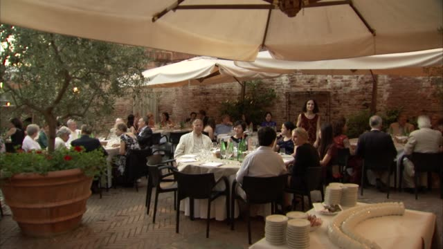 central bankers and economists conference in Siena Italy / gathering and sitting for dinner at economist's Robert Mundell's castle where the...