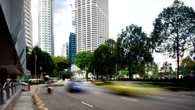 vidéos et rushes de quartier central des affaires de singapour - véhicule utilitaire léger