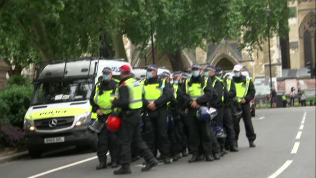 central london protests; england: london: westminster: ext protesters marching along whitehall with placards and flags including extinction... - clock tower stock videos & royalty-free footage