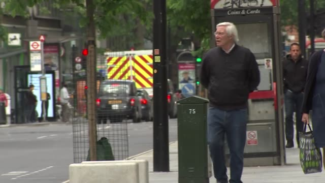 central london traffic and pedestrians during coronavirus lockdown; england: london: tottenham court road: ext pedestrians along relatively quiet... - tottenham court road stock videos & royalty-free footage