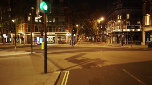 central london uk devoid of people and traffic at dusk in shaftesbury avenue - central london video stock e b–roll