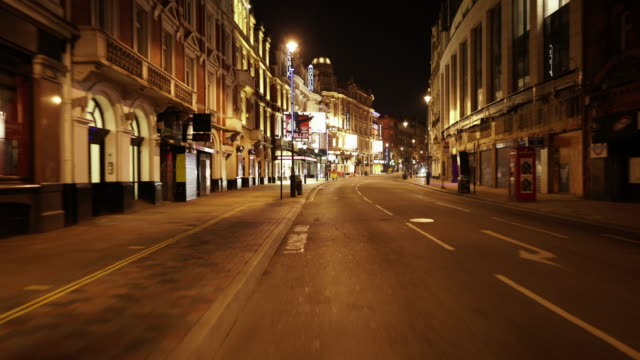central london uk devoid of people and traffic at dusk in shaftesbury avenue - city of westminster london stock videos & royalty-free footage