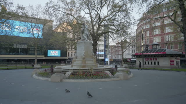 central london uk devoid of people at dusk in leicester square - international landmark stock videos & royalty-free footage