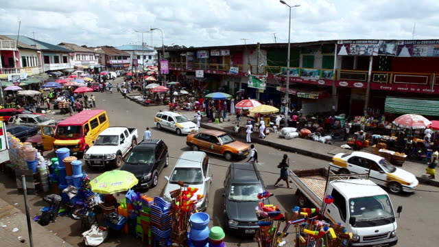 a central market and cars in the streets in takoradi, ghana - ghana stock videos & royalty-free footage