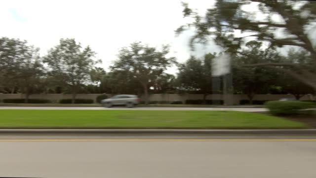 central naples xvii synced series left view driving process plate - naples florida stock videos & royalty-free footage