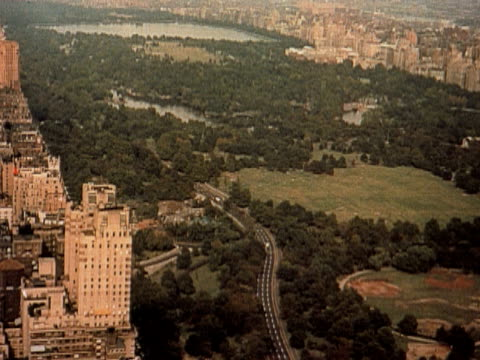 1960 AERIAL Central Park and apartment buildings along Central Park West / New York City