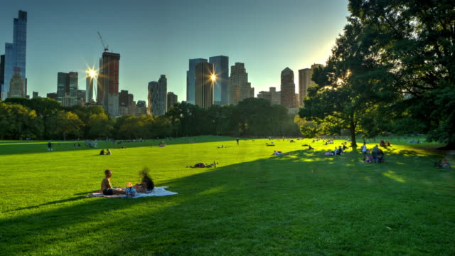 Central park at sunset with crowd of people New York City
