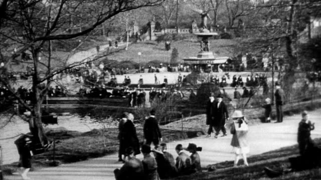 central park boat house / people alongside lake / bethesda fountain / people in row boats in lake arched bridge over central park lake / people... - 1916 stock videos & royalty-free footage