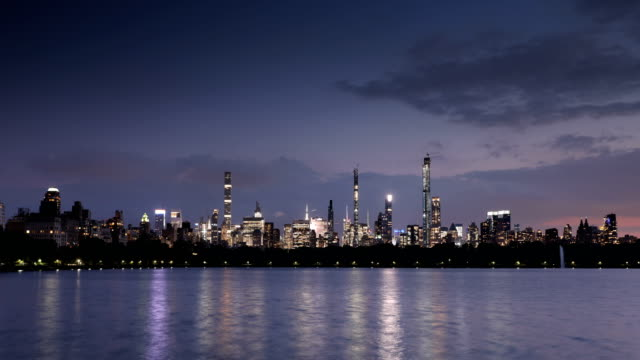 central park dusk to night time lapse - central park reservoir stock videos and b-roll footage