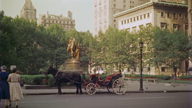 1956 ws central park horse and carriages near plaza hotel / manhattan, new york - 1956 stock videos & royalty-free footage