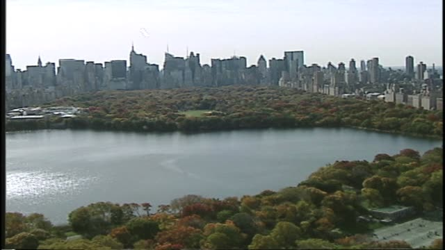 central park new york city aerial shot over reservoir central par aerial over reservoir on january 02 2012 - salmini stock videos & royalty-free footage