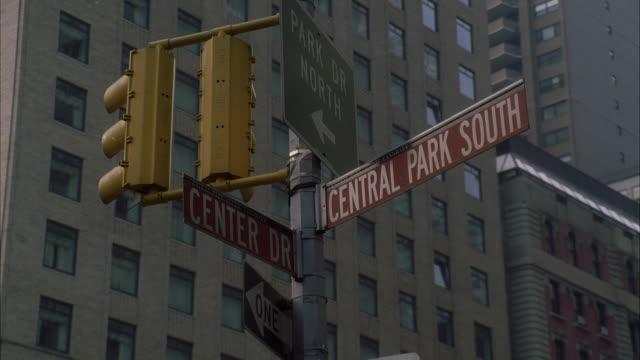 CU LA Central Park South/Center Drive/Park Dr-North street sign / New York City, New York, USA