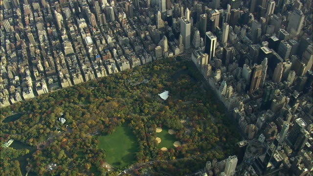 AERIAL WS Central Park, Traverse to 58th Street and Manhattan Midtown West / New York City, New York, USA