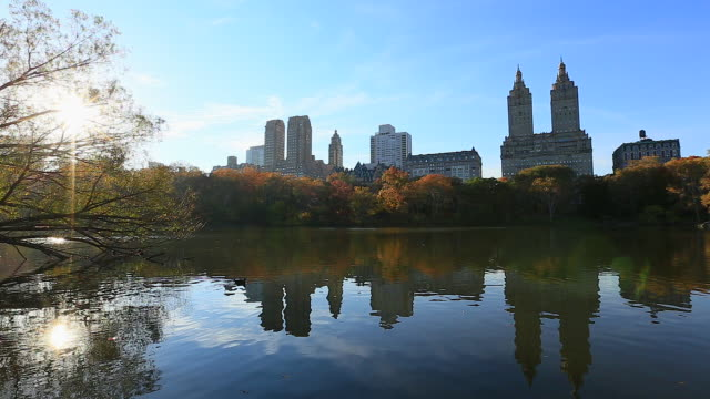 central park west residents and the san remo reflected in the lake. - remo stock videos and b-roll footage