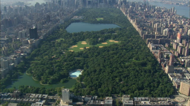 aerial central park with jacqueline kennedy onassis reservoir / manhattan, new york city, new york, usa - central park reservoir stock videos and b-roll footage