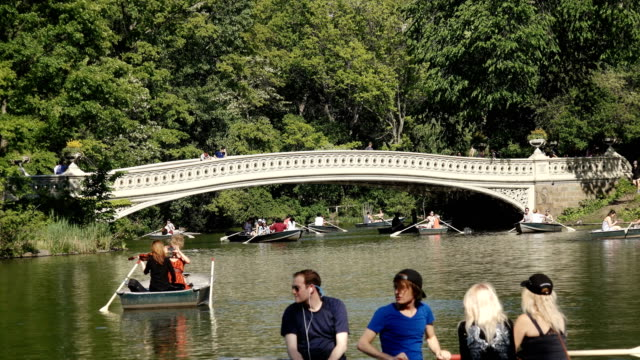 central park's bow bridge and lake, new york city - central park manhattan stock videos & royalty-free footage