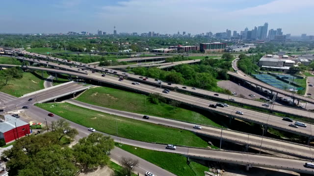 Central Texas Aerial View of Mopac Expressway and Austin Texas Downtown Skyline normal speed lower down during Spring Time
