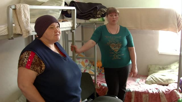 a centre in slavyansk run by a pastor welcomes internally displaced people from the conflict in ukraine - pastor stock videos & royalty-free footage