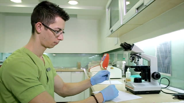 centrifuge of human stool sample in microbiology lab - stool stock videos & royalty-free footage