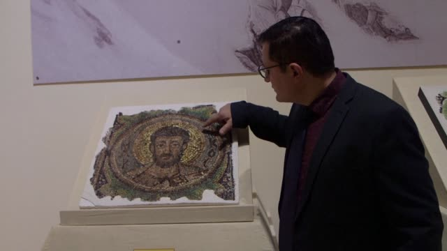 vídeos y material grabado en eventos de stock de centuries-old mosaic of saint mark is on display at a cyprus museum that now plans to reunite it with the 11 other apostles decades after it was... - mosaico