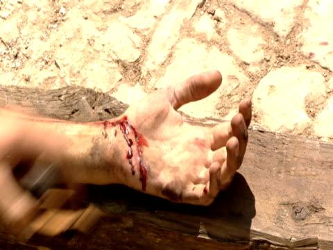 A centurion prepares Christ for crucifixion.