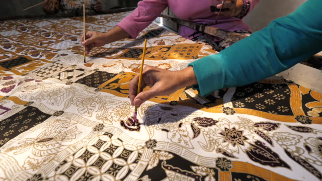 cepu traditional batik maker. - batik stock videos and b-roll footage
