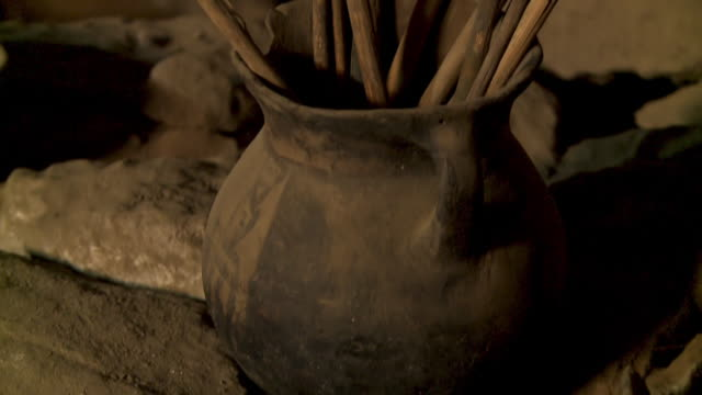ceramic pot in cemetery cave, altiplano , bolivia - utensil stock videos & royalty-free footage