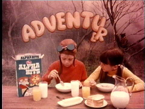 cereal-eating boy and girl are threatened by a vampire and a man in a gorilla suit. - 1974 bildbanksvideor och videomaterial från bakom kulisserna