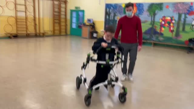 cerebral palsy sufferer george muderack walks to raise money for children in need; england: london: richmond: int george muderack sitting in... - competition stock videos & royalty-free footage