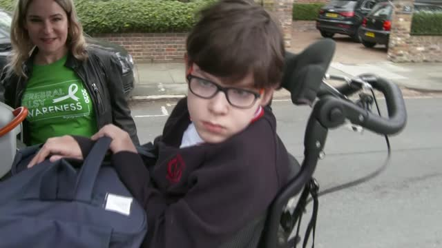 cerebral palsy sufferer george muderack walks to raise money for children in need; england: london: richmond: int reporter sat with george muderack ,... - persons with disabilities stock videos & royalty-free footage
