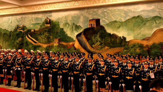 a ceremonial guard wait for an inspection by british prime minister theresa may and chinese premier li keqiang in the great hall of the people on... - minister president stock videos and b-roll footage