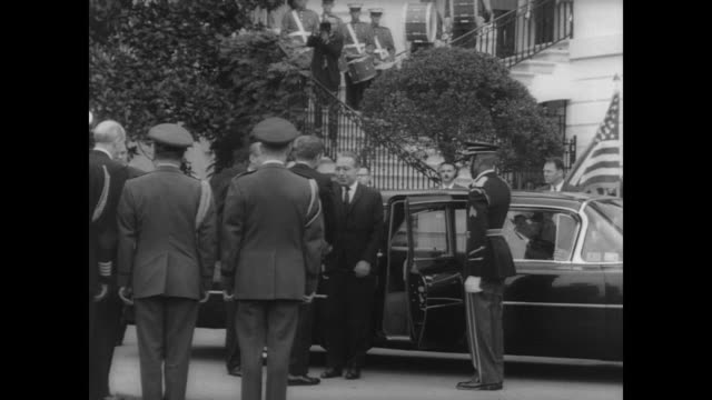 ceremonial welcome by president john f kennedy for bolivian president paz estenssoro / presidents shake hands as estenssoro exits car / review of... - state visit stock videos & royalty-free footage