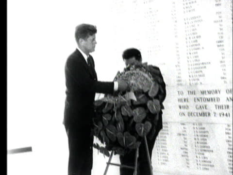 jfk ceremoniously installs a wreath in front of the memorial plaque wall - memorial plaque stock videos and b-roll footage