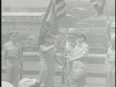 Ceremony awarding General of the Army Douglas MacArthur Douglas shaking hands w/ Chief of Staff of United States Army J Lawton Collins