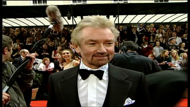 stockvideo's en b-roll-footage met london ext reporter to camera noel edmonds interview sot knew would be successful because it had been successful around the world / nobody knew it... - noel edmonds
