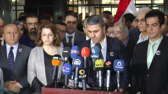 ceremony held at iraqi parliament to commemorate 29th anniversary of halabja massacre in baghdad iraq on march 16 2017 speaker of the iraqi... - massenvernichtungswaffe stock-videos und b-roll-filmmaterial
