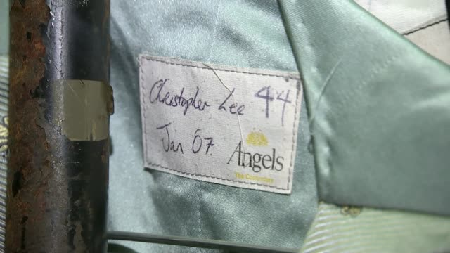 ceremony honours angels costume company with special award; lib north london; angels costumiers: int high angle gv racks of clothes hanging on rails... - ローレンス オリビエ点の映像素材/bロール