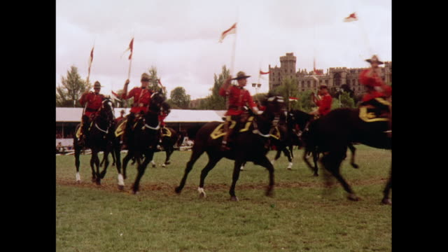 montage ceremony of royal canadian mounted police outside of windsor castle in london / united kingdom - ウィンザー城点の映像素材/bロール
