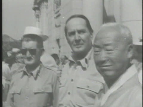 Ceremony of the First Republic of Korea US Generals John R Hodge Douglas MacArthur First President Syngman Rhee watching large groups of Korean...