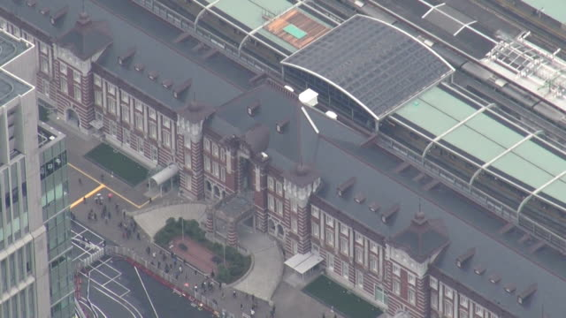 a ceremony to celebrate the 100th anniversary of the opening of tokyo station was held on friday december 19 at the iconic redbrick station building... - 式典点の映像素材/bロール